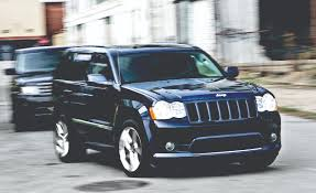 acura jeep 2009 2010 bmw x5 m vs 2009 jeep grand cherokee srt8 2010 land rover