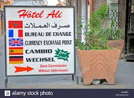 bureau de change sans commission sign currency exchange office in five languages marrakech stock
