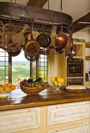 kitchen island pot rack this rustic country kitchen look with a hint of country