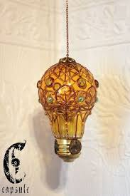 this website lists ways to creatively reuse lightbulbs including