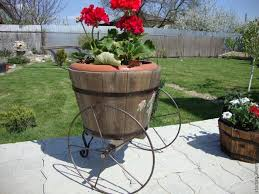 Planters On Wheels by Recycling Antique Wheels For Unique Garden Decorations In Vintage