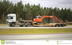 red volvo f12 intercooler hauls a hitachi zaxis excavator