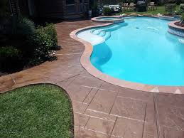 recolored and re sealed stamped concrete pool deck magnolia tx