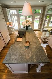 costa esmeralda granite warms up this kitchens island and