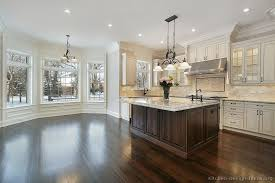 pictures of white kitchen cabinets with island traditional two tone kitchen cabinets antique white