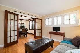 craftsman living room with chandelier u0026 french doors in saint paul
