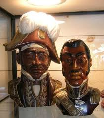 two haitian carved and painted wood busts of generals j j