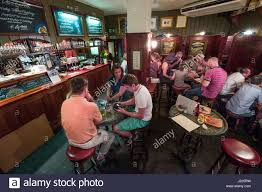 people sitting at tables in the basement of the westminster arms