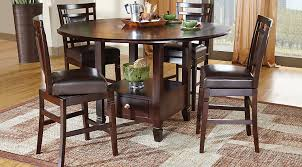 5 pc round pedestal dining table landon chocolate 5 pc counter height dining set room sets with
