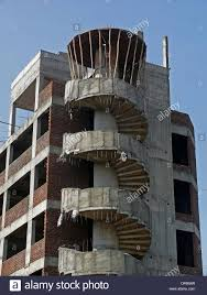 structure of a building under construction with curved staircase