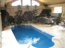stunning small residential indoor pool design with cream concrete