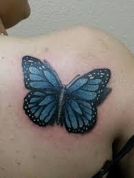 blue monarch butterfly on shoulder