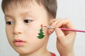 caucasian boy child face painting fir tree for party