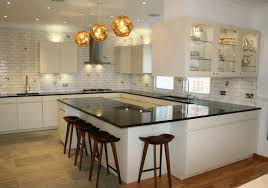 small u shaped kitchen with island tile backsplash