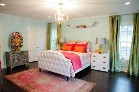 bedroom luxury white master bed and two orange pillows also glass