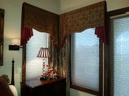 soft cornice valance with jabots for elegant master bedroom
