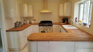 cream gloss kitchen with wooden worktop deductour com