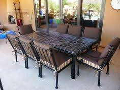 slate outdoor dining table outdoor chaise lounge chairs hand forged iron patio furniture