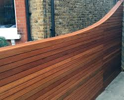 horizontal cedar hardwood strip wood trellis screen fence oiled