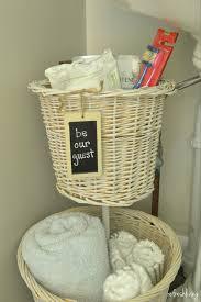 diy bathroom storage from old baskets refresh living upcycled baskets diy bathroom organizer