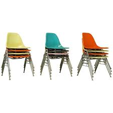vintage mid century eames fiberglass stacking shell chairs dss n