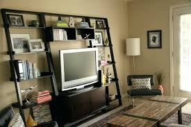 furniture leaning shelves tv stand and accent chair with floor