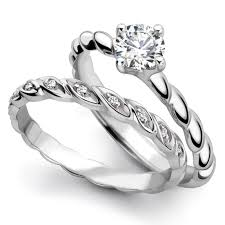 wedding ring sets uk brilliant cut diamond engagement ring rosebud set
