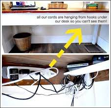 how to organize cables under desk use hooks underneath your desk to keep wires out of the way home