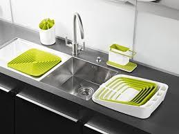 kitchen sink cabinet sponge holder joseph joseph sink caddy kitchen soap and sponge holder white and green