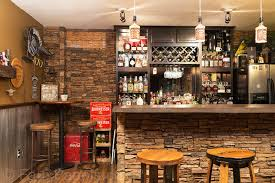 home bar designs simply gorgeous ideas with fauxpanels give your home bar a more refined quality with faux stone paneling