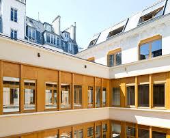 parc architectes renovate a 19th century office building in paris