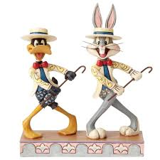 the daffy duck show amazon com jim shore looney tunes on with the show bugs bunny