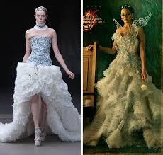 effie and katniss u0027 dresses in their capitol couture portraits are