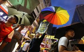 Kentucky travel umbrella images Resolute occupy protesters raise umbrellas to commemorate firing jpg