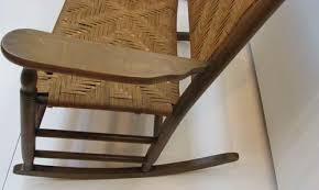antique double rocker with woven seat back