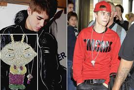 justin bieber turns jewelry designer by a stewie griffin necklace