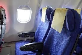 siege avion siège d avion bleu et fenêtre à l intérieur d un avion
