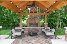 wonderful brick outdoor fireplace with red column wood beams