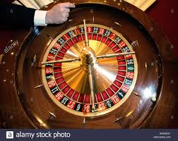 Casino Bad Homburg A Croupier Spins A Ball On A Roulette Wheel At A Roulette Table At