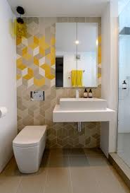 stylish small bathroom idea with geometric wallpaper and clear