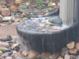 rain downspout catch basin in action during a downpour garden