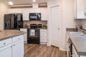 Kitchens With White Cabinets And Black Appliances Modular Homes Kitchens Franklin Homes
