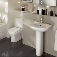 standar porcelain pedestal sink sleek black soap dispenser smooth