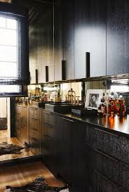 black cabinets with mirrored backsplash contemporary kitchen