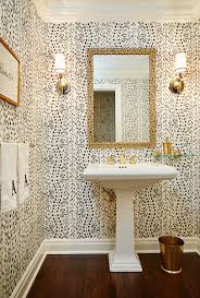 love this powder room such fun wallpaper print and love the gold