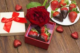 s day strawberries box with tasty chocolate dipped strawberries and the on table
