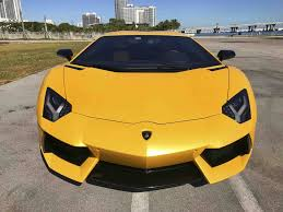 yellow lamborghini lamborghini aventador coupe for rent in miami paramount luxury
