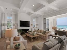 open windows living room wall mounted tv decor light wood flooring