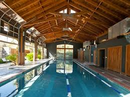 garage doors indoor outdoor pool the barnhouse pool at the lake
