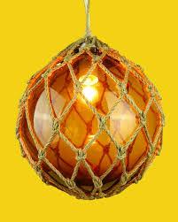 glass fishing float pendant light nautical glass fish float light amber cheeky tiki ltd